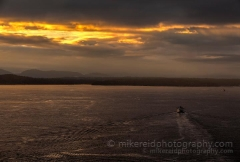 Ferry Heading West : sunset, sunrise, seattle, northwest photography, dramatic, beautiful, washington, washington state photography, northwest images, seattle skyline, city of seattle, puget sound, aerial san juan islands