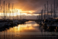 Shilshole Golden Sunset  Potential for a burning sunset along the mountains insisted I drive out to the Marina. To order a print please email me at  Mike Reid Photography : sunset, sunrise, seattle, northwest photography, dramatic, beautiful, washington, washington state photography, northwest images, seattle skyline, city of seattle, puget sound, aerial san juan islands